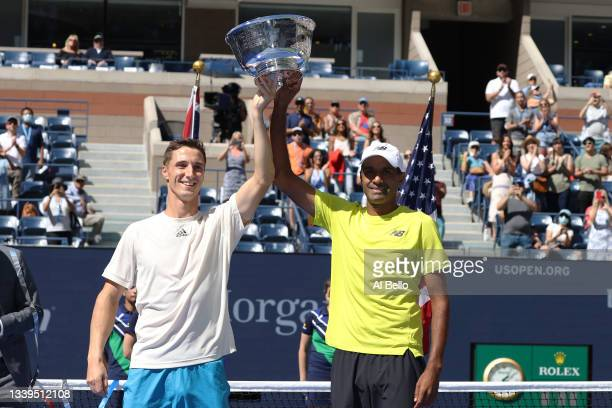 Joe Salisbury of Great Britain and Rajeev Ram of the United States celebrate with the trophy after defeating Jamie Murray of Great Britain and Bruno...
