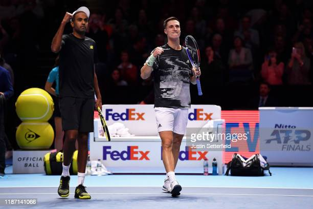Joe Salisbury of Great Britain and Rajeev Ram of the USA celebrate victory after their doubles match against Ivan Dodig of Croatia and Filip Polasek...