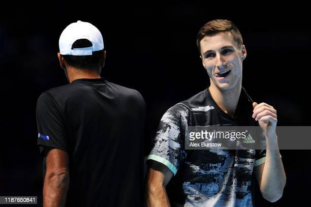 Joe Salisbury of Great Britain and Rajeev Ram of the USA react in their doubles match against Marcelo Melo of Brazil and Lukasz Kubot of Poland...