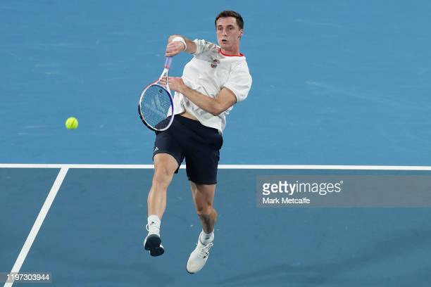 Joe Salisbury of Great Britain celebrate hits a smash during their Group C doubles match against Gregor Dimitrov and Alexander Lazarov of Bulgaria...