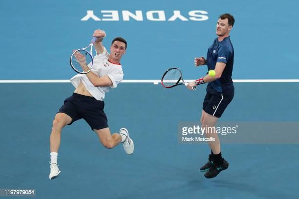 Joe Salisbury of Great Britain plays an overhead smash alongside Jamie Murray of Great Britain during their Group C doubles match against Radu Albot...