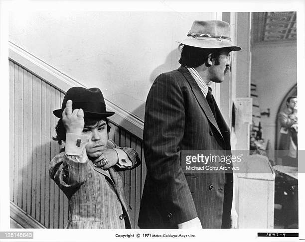 Joe Santos and Herve Villechaize leave the police station in a scene from the film 'The Gang That Couldn't Shoot Straight' 1971