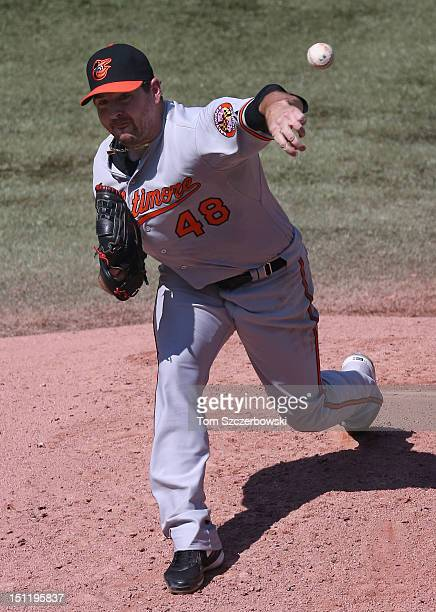 Joe Saunders of the Baltimore Orioles delivers a pitch during MLB game action against the Toronto Blue Jays on September 3 2012 at Rogers Centre in...