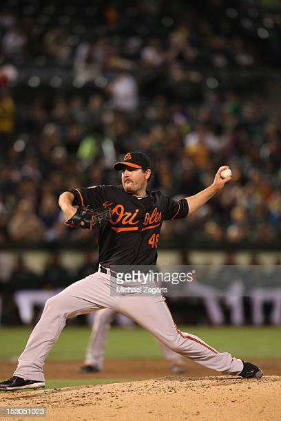 Joe Saunders of the Baltimore Orioles pitches during the game against the Oakland Athletics at the OaklandAlameda County Coliseum on September 14...