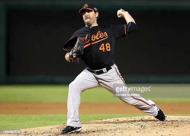 Joe Saunders of the Baltimore Orioles throws a pitch against the Texas Rangers during the American League Wild Card playoff game at Rangers Ballpark...