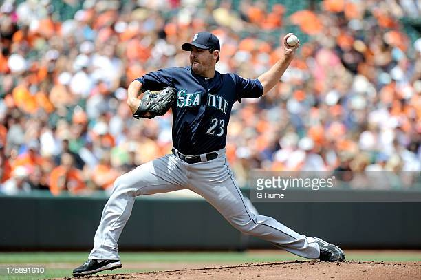 Joe Saunders of the Seattle Mariners pitches against the Baltimore Orioles at Oriole Park at Camden Yards on August 4 2013 in Baltimore Maryland