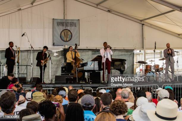 Joe Saylor Eddie Barbash Philip Kuehn Jon Batiste and Ibanda Ruhumbika of Jon Batiste and Stay Human perform during the Newport Jazz Festival 2013 at...