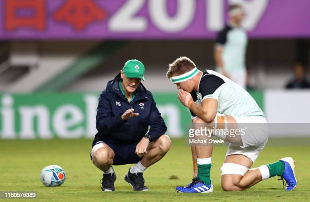 Joe Schmidt Head Coach of Ireland speaks with Josh Van Der Flier of Ireland prior to the Rugby World Cup 2019 Group A game between Ireland and Samoa...