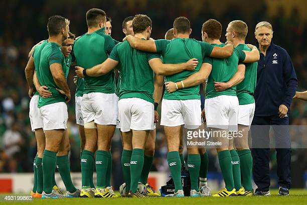 Joe Schmidt Head Coach of Ireland speaks with members of his squad before the warmup ahead of the 2015 Rugby World Cup Quarter Final match between...
