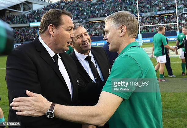 Joe Schmidt the head coach of Ireland shakes hands with Steve Hansen the head coach of New Zealand and Wayne Bennett the New Zealand assistant coach...