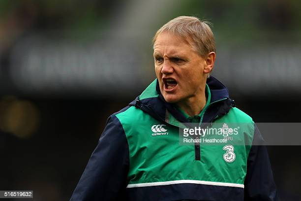 Joe Schmidt the head coach of Ireland watches over his team warm up prior to kickoff during the RBS Six Nations match between Ireland and Scotland at...