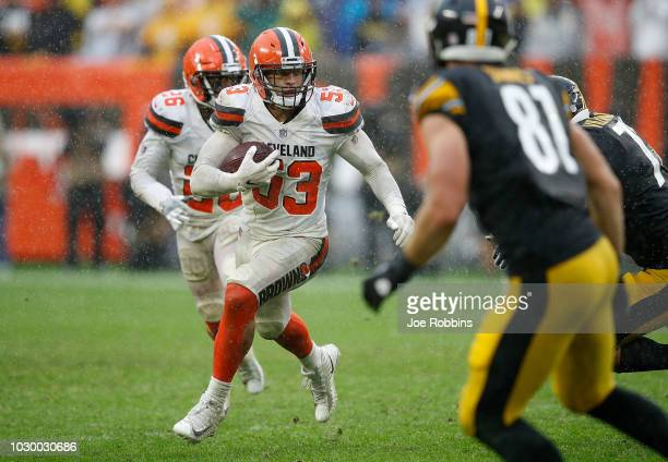 Joe Schobert of the Cleveland Browns returns an interception during overtime against the Pittsburgh Steelers the at FirstEnergy Stadium on September...