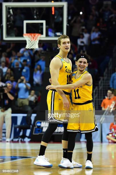Joe Sherburne and his teammate KJ Maura of the UMBC Retrievers react during their game against the Virginia Cavaliers during the first round of the...