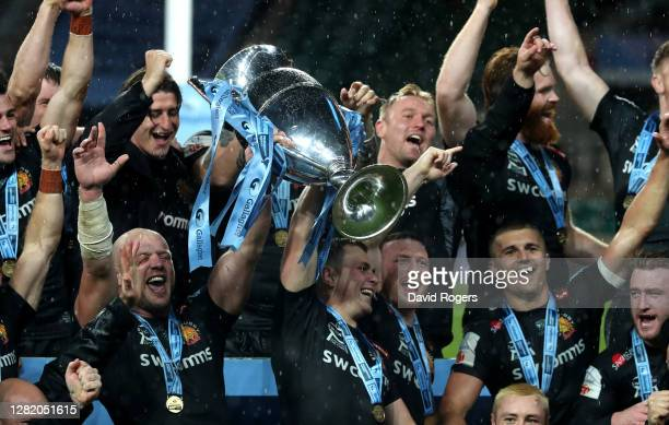 Joe Simmonds and Jack Yeandle, the co captains of Exeter Chiefs, raise the Premiership trophy as they celebrate with team mates after their victory...