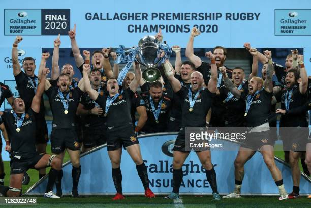 Joe Simmonds of Exeter Chiefs and Jack Yeandle of Exeter Chiefs lift the Gallagher Premiership Trophy following their team's victory in the Gallagher...