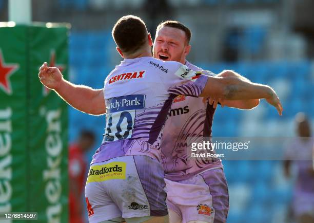 Joe Simmonds of Exeter Chiefs celebrates with his brother Sam Simmonds after scoring their fourth try during the Heineken Champions Cup Semi Final...