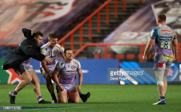 Joe Simmonds of Exeter Chiefs is congratulated by Ollie Devoto and Luke Cowan-Dickie of Exeter Chiefs after victory in the Heineken Champions Cup...