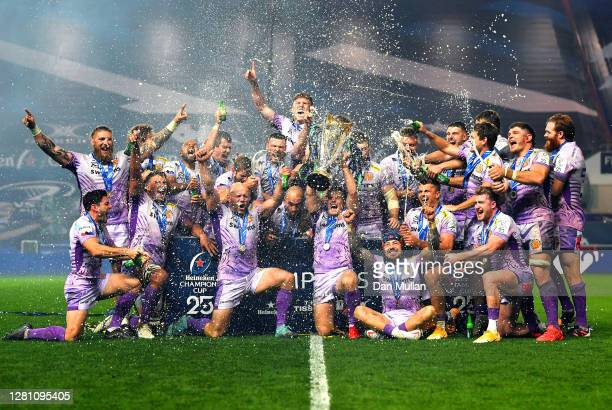 Joe Simmonds of Exeter Chiefs lifts the trophy with his teammates after victory in the Heineken Champions Cup Final match between Exeter Chiefs and...