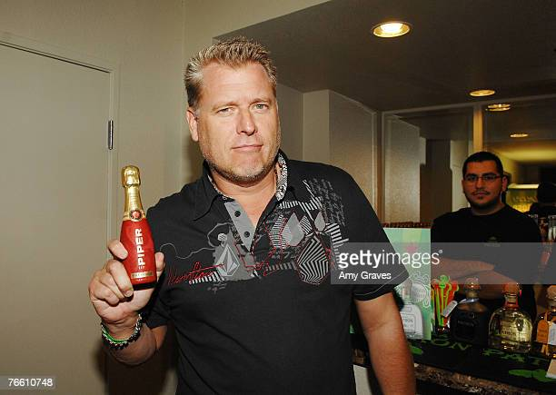 Joe Simpson holds a bottle of Piper Heidsieck champagne at the Star Lounge In Honor of Rolling Stone's 40th Anniversary at the Hard Rock Hotel and...
