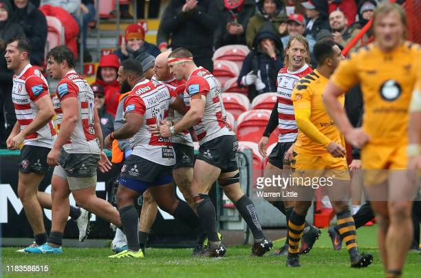 Joe Simpson of Gloucester is congratulated after scoring the opening try during the Gallagher Premiership Rugby match between Gloucester Rugby and...