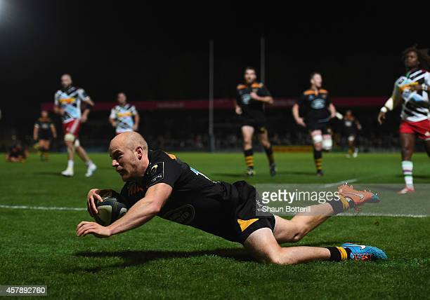 Joe Simpson of Wasps scores a try during the European Rugby Champions Cup match between Wasps and Harlequins at Adams Park on October 26 2014 in High...
