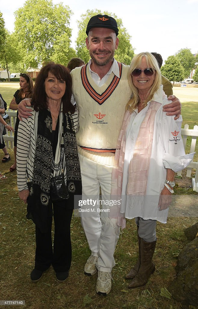 Joe Sims (C), Susan George (R) and guest attend the Flannels for Heroes charity cricket match and garden party hosted by menswear brand Dockers at Burton's Court on June 19, 2015 in London, England.