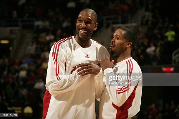 Joe Smith and Damon Jones of the Cleveland Cavaliers have a long laugh during warmups prior to the game against the Chicago Bulls on April 3 2008 at...
