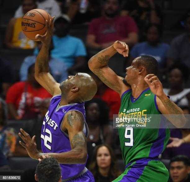 Joe Smith of Ghost Ballers guards Rashard Lewis of the 3 Headed Monsters during the BIG3 game at Staples Center on August 13 2017 in Los Angeles...