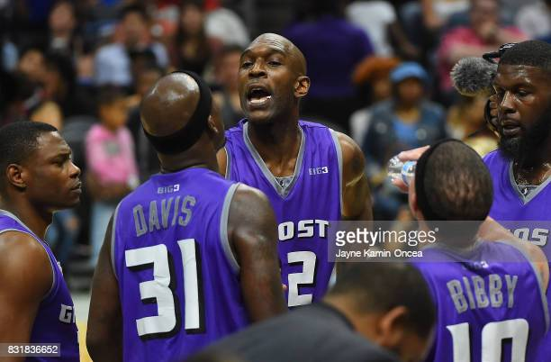Joe Smith of Ghost Ballers huddles for a time out with Ivan Johnson Joe Smith Marcus Banks Ricky Davis and Mike Bibby during the BIG3 game against...