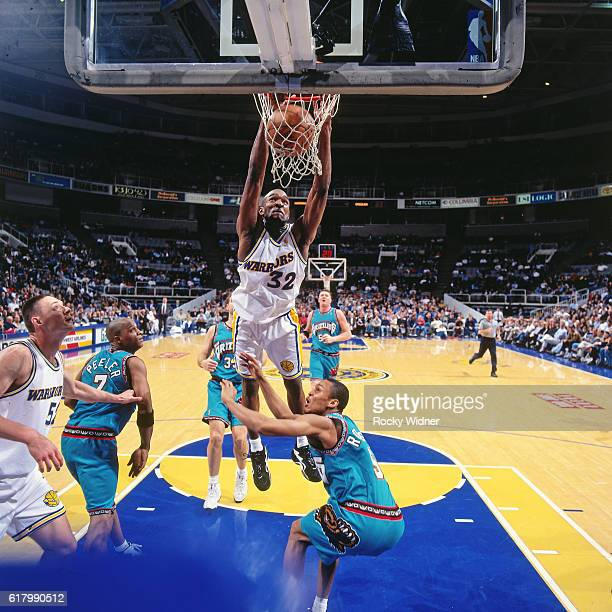 Joe Smith of the Golden State Warriors dunks against the Vancouver Grizzlies circa 1997 at San Jose Arena in San Jose California NOTE TO USER User...