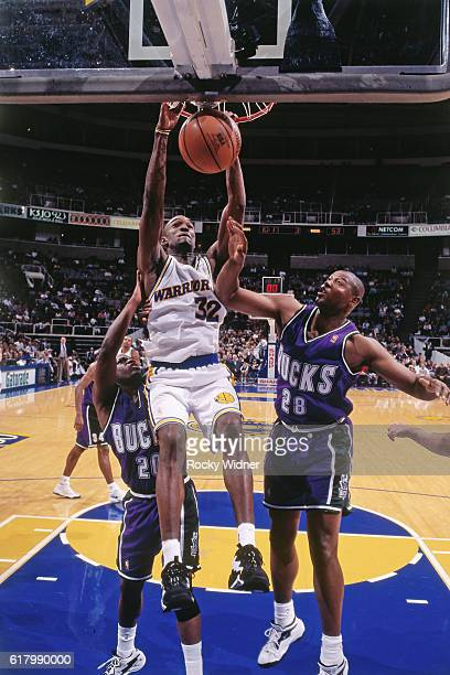 Joe Smith of the Golden State Warriors dunks during a game circa 1997 at San Jose Arena in San Jose California NOTE TO USER User expressly...