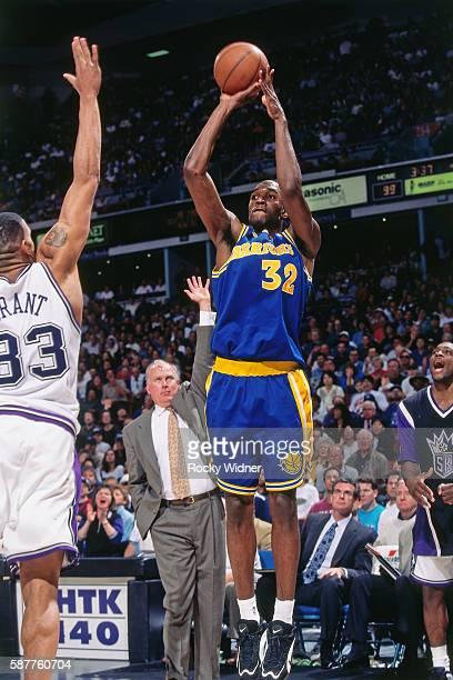 Joe Smith of the Golden State Warriors shoots against Sacramento Kings circa 1997 at Arco Arena in Sacramento California NOTE TO USER User expressly...