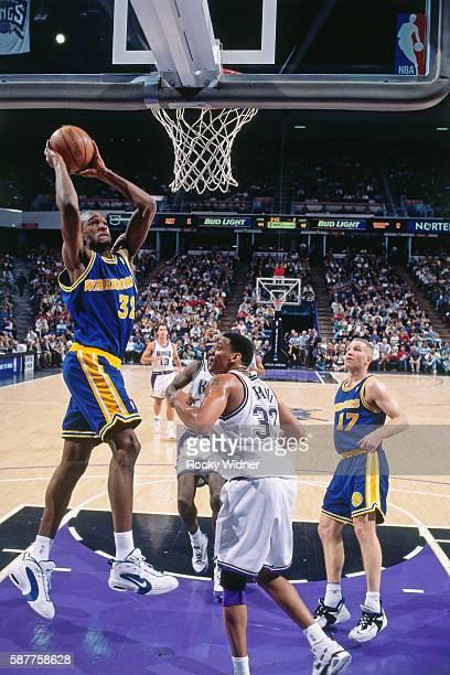 Joe Smith of the Golden State Warriors shoots against the Sacramento Kings circa 1996 at Arco Arena in Sacramento California NOTE TO USER User...