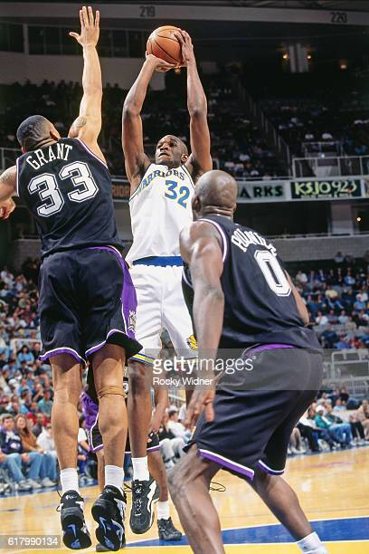 Joe Smith of the Golden State Warriors shoots against the Sacramento Kings circa 1997 at San Jose Arena in San Jose California NOTE TO USER User...