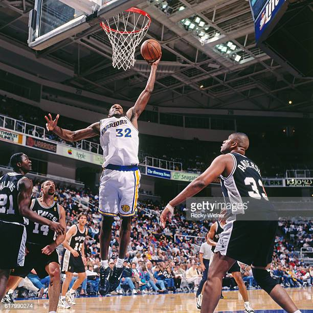 Joe Smith of the Golden State Warriors shoots against the San Antonio Spurs circa 1997 at San Jose Arena in San Jose California NOTE TO USER User...