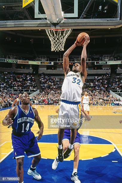 Joe Smith of the Golden State Warriors shoots during a game circa 1997 at San Jose Arena in San Jose California NOTE TO USER User expressly...