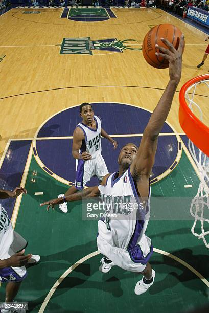 Joe Smith of the Milwaukee Bucks grabs the ball during the game against the Cleveland Cavaliers at the Bradley Center on April 2 2004 in Milwaukee...