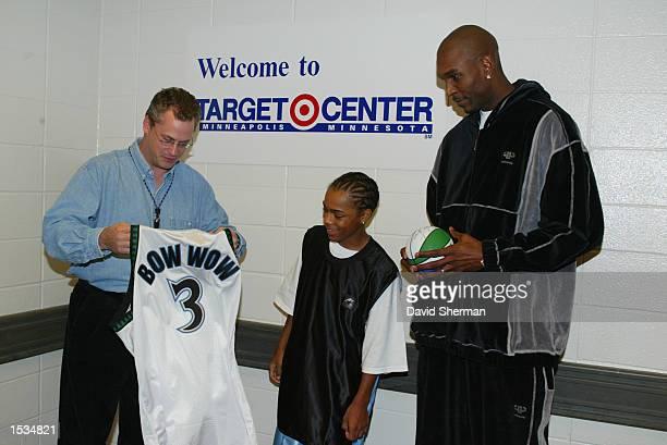 Joe Smith of the Minnesota Timberwolves and Steve Mattson Target Center Executive Director present a personalized Minnesota Timberwolves jersey to...