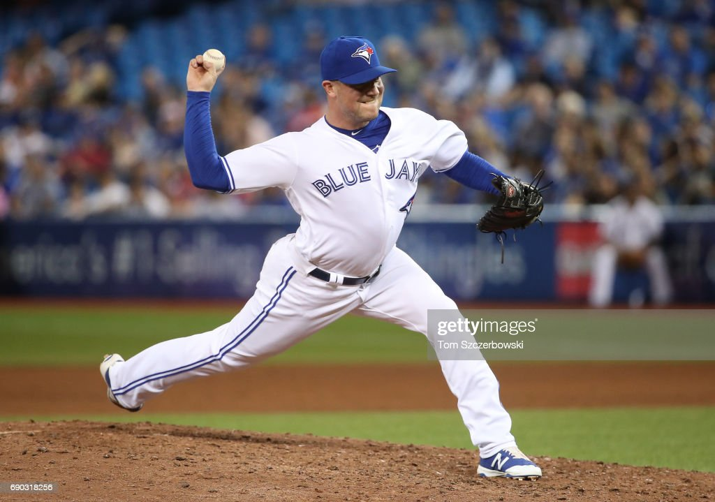 Joe Smith #38 of the Toronto Blue Jays delivers a pitch in the eighth inning during MLB game action against the Cincinnati Reds at Rogers Centre on May 30, 2017 in Toronto, Canada.