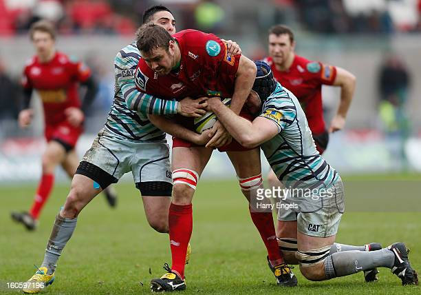 Joe Snyman of Scarlets is tackled by the Leicester defence during the LV= Cup match between Scarlets and Leicester Tigers at Parc y Scarlets on...