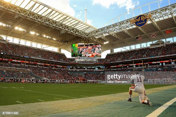 Joe Spaziani of the Virginia Cavaliers looks on during a game against the Miami Hurricanes at Hard Rock Stadium on November 18, 2017 in Miami...