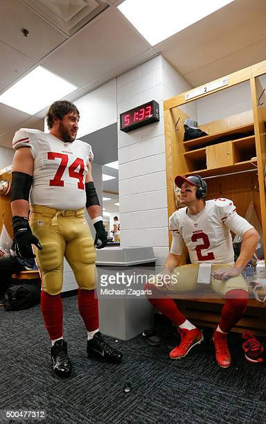 Joe Staley and Blaine Gabbert of the San Francisco 49ers talk in the locker room prior to the game against the Chicago Bears at Soldier Field on...