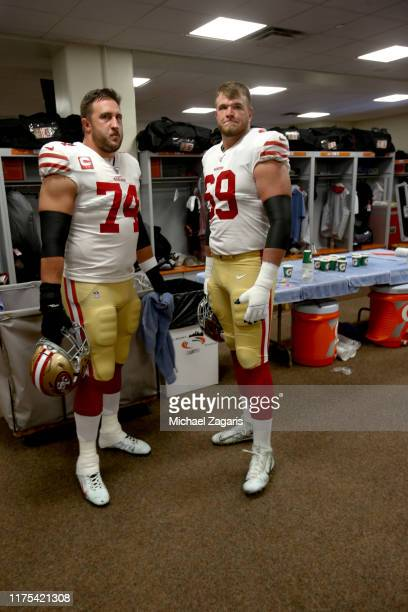 Joe Staley and Mike McGlinchey of the San Francisco 49ers stand in the locker room prior to the game against the Cincinnati Bengals at Paul Brown...