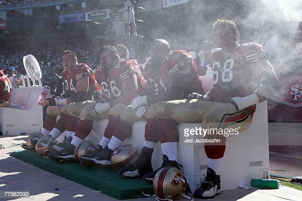 Joe Staley Eric Heitmann Larry Allen Adam Snyder of the San Francisco 49ers cool off on the bench against the Baltimore Ravens during an NFL game on...