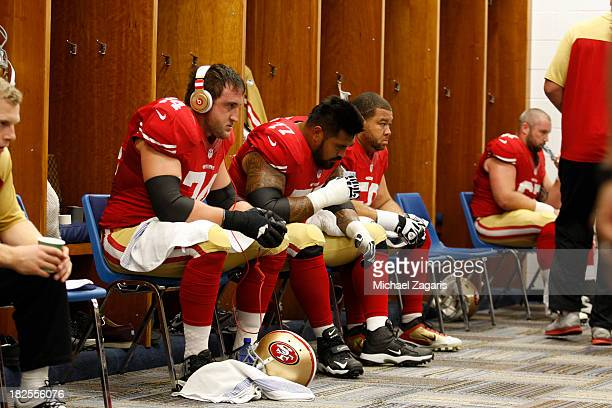 Joe Staley Mike Iupati and Jonathan Goodwin of the San Francisco 49ers relax in the locker room prior to the game against the St Louis Rams at the...