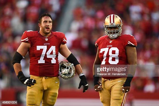 Joe Staley of the San Francisco 49ers and Joe Looney wait for an official review during the fourth quarter against the St Louis Rams at Levi's...
