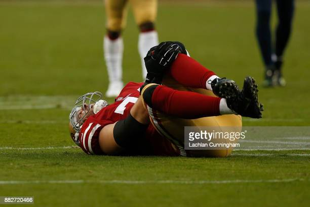 Joe Staley of the San Francisco 49ers holds his knee after a play against the Seattle Seahawks at Levi's Stadium on November 26 2017 in Santa Clara...