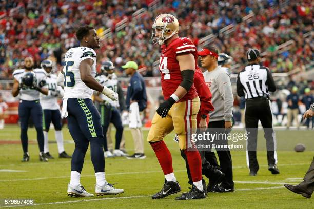 Joe Staley of the San Francisco 49ers leaves the field after receiving medical attention during the game against the Seattle Seahawks at Levi's...