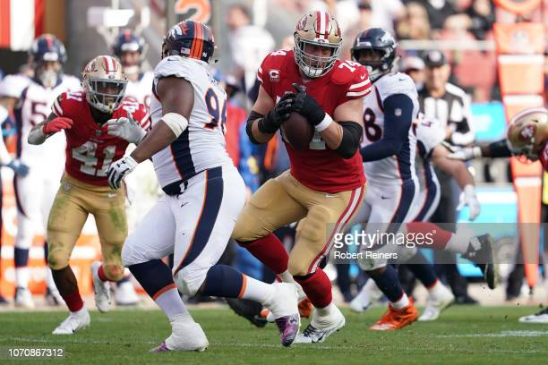 Joe Staley of the San Francisco 49ers makes a catch against the Denver Broncos during their NFL game at Levi's Stadium on December 9 2018 in Santa...