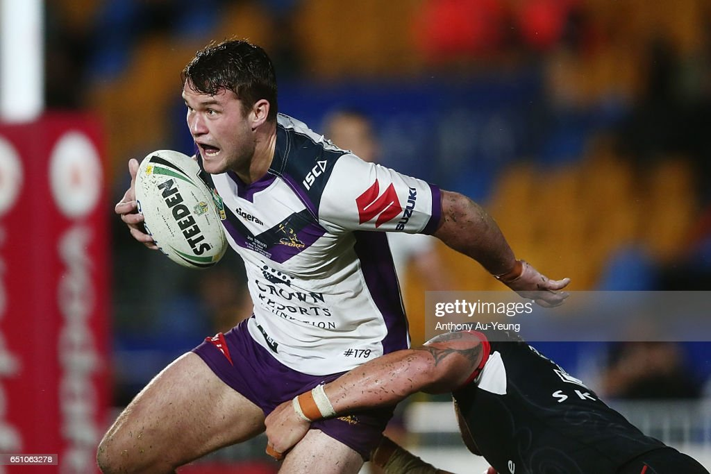 Joe Stimson of the Storm is tackled by Bodene Thompson of the Warriors during the round two NRL match between the New Zealand Warriors and the Melbourne Storm at Mt Smart Stadium on March 10, 2017 in Auckland, New Zealand.